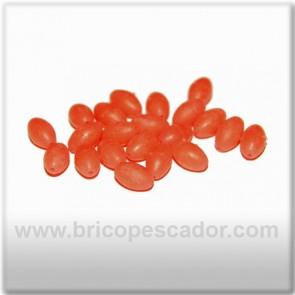 Perla perfofada luminiscente naranja de 8 x 5 mm.